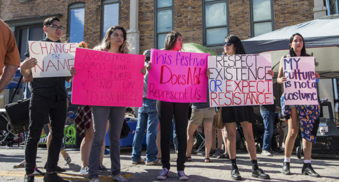 People gather to protest Denton's Day of The Dead Festival