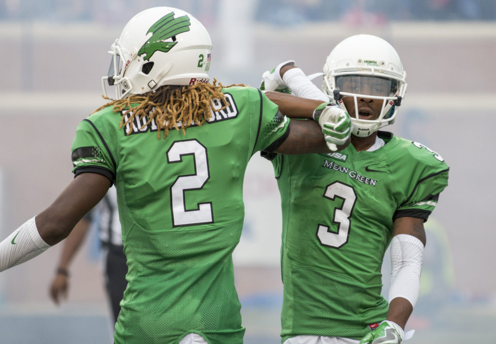 North Texas wide receivers O'Keeron Rutherford (2) and Terian Goree (3) celebrate after Goree scored a touchdown. Colin Mitchell