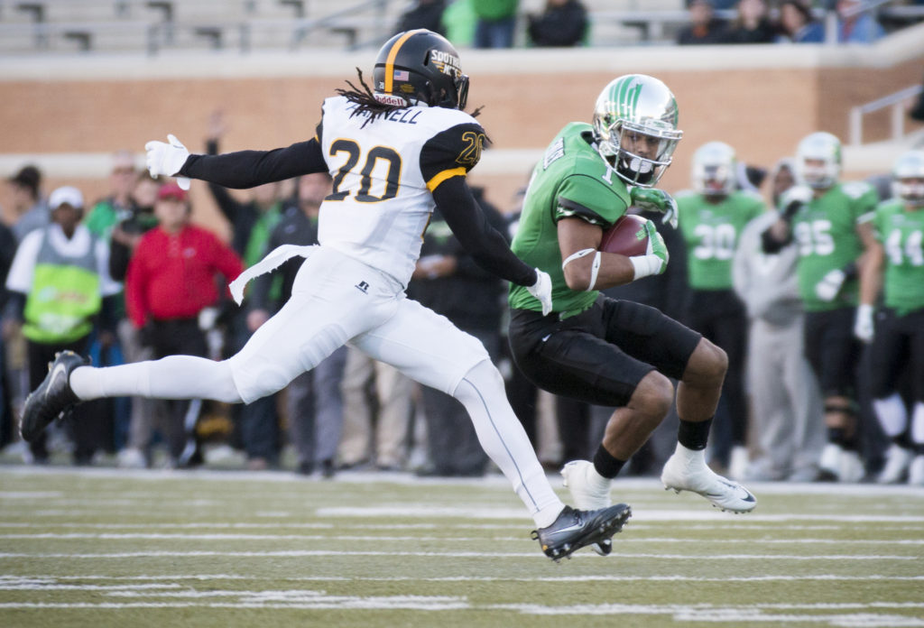 Junior wide receiver Turner Smiley jukes a defender in the first half against Southern Miss. Colin Mitchell