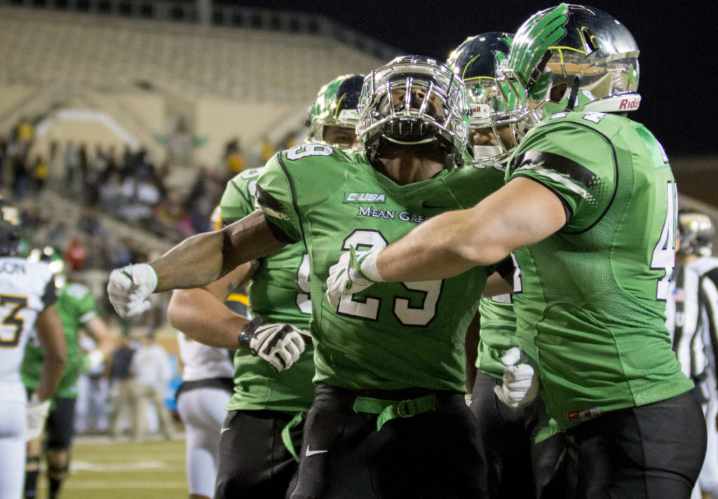 Junior running back Willy Ivery celebrates after scoring late against Southern Miss. Colin Mitchell