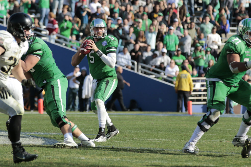 North Texas senior running back Alec Morris looks to pass to the outside with less than three minutes left in the fourth quarter against Army in the Heart of Dallas Bowl. Colin Mitchell