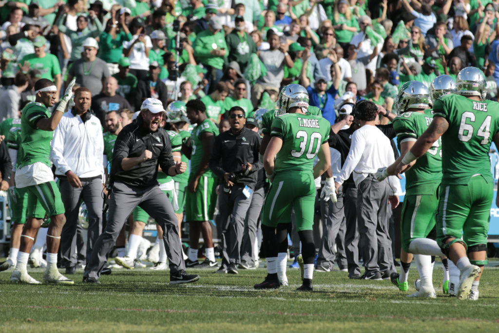 North Texas junior kicker Trevor Moore (30) celebrates on the sideline after hitting the game tying field goal with 28 seconds left in the game against Army to force overtime in the Heart of Dallas Bowl. Colin Mitchell