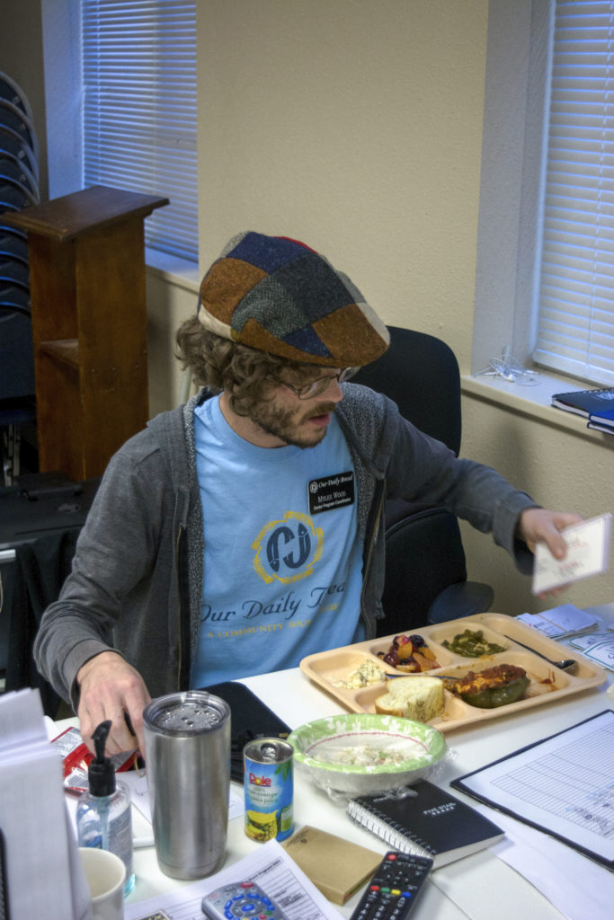 Myles Wood eats his lunch while answering phone calls. Ruben Paquian