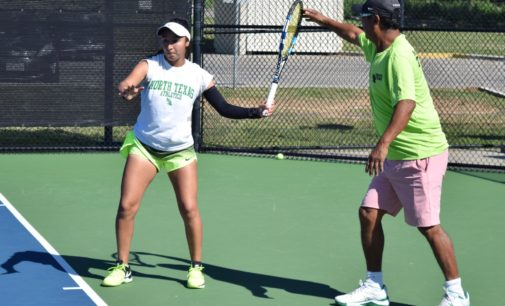 Volunteer coach Raj Lama lending a hand, sharing experiences with Mean Green tennis
