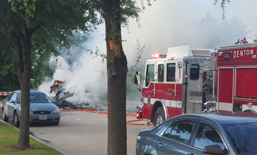 Fire outside Gateway apartments caused by trash inside garbage truck