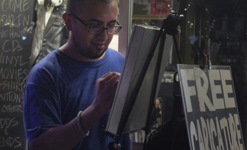 Drawing Denton: Free caricature artist brings the Square to life