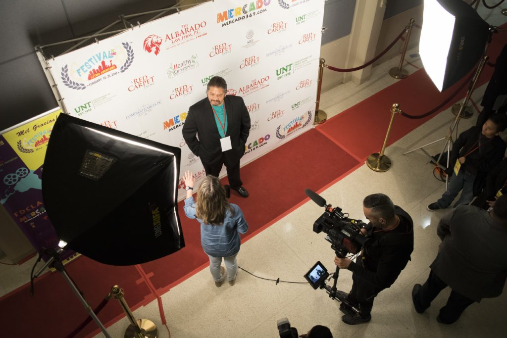 Edgar Arreola gets interviewed at the Festival de Cine Latino Americano.