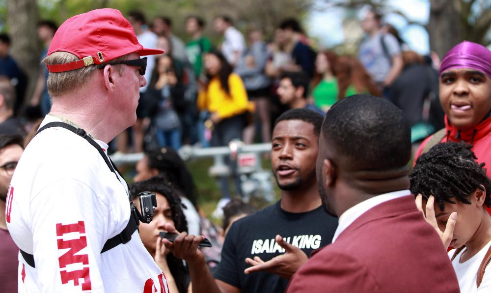 Students talk with a protester during a protest Wedensday.