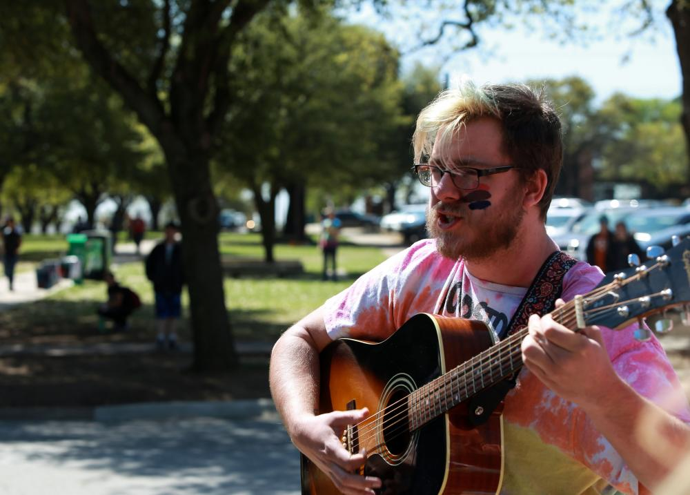 A student sings and plays guitar during a protest, Friday. Rachel Walters