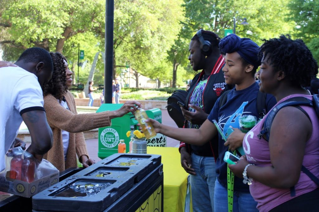 Students receive free Huberts Lemonade at Earth Fest Thursday evening.