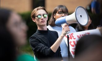 Students protest ICE at the UNT Library Mall on Wednesday