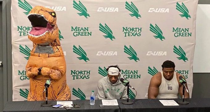Fine dons dinosaur costume following career game