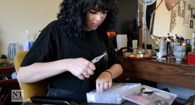 UNT student sells her acrylic pours and resin earrings