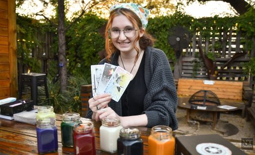 The Storm Witch shares 'witchy' themes through candles and tarot readings