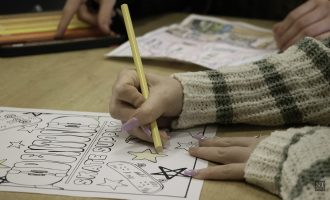 Guyer High School art class helps save Rose Costumes with 'Only In Denton' coloring book