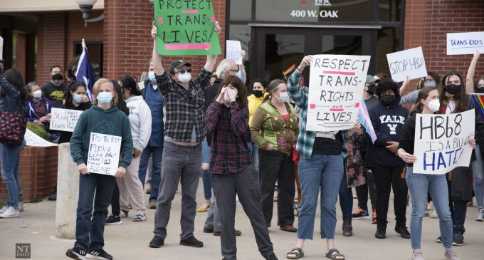 Trans rights activists hold protest outside state Rep. Lynn Stucky's office